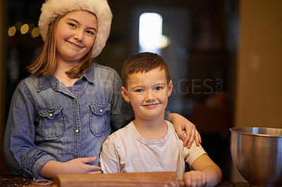 Buy stock photo Shot of a happy brother and sister baking at home during Christmas
