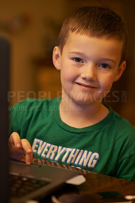 Buy stock photo Portrait  of a happy little boy using a laptop at home