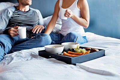 Buy stock photo Cropped shot of a mature couple having breakfast in bed