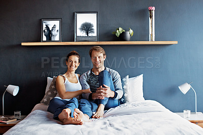 Buy stock photo Portrait of a smiling mature couple sitting in bed