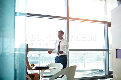 Buy stock photo Shot of two businesspeople talking together in an office