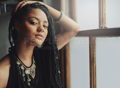 Buy stock photo Cropped shot of an attractive young woman standing by the window