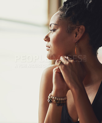 Buy stock photo Cropped shot of an attractive young woman sitting by the window