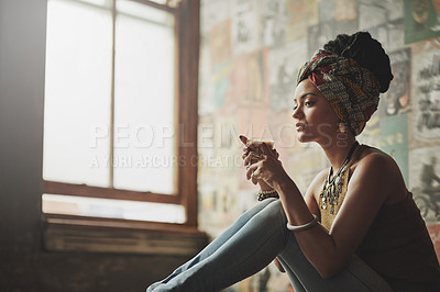 Buy stock photo Cropped shot of an attractive young woman drinking coffee