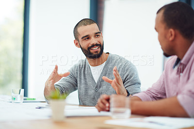 Buy stock photo Cropped shot of two businessmen working in their office