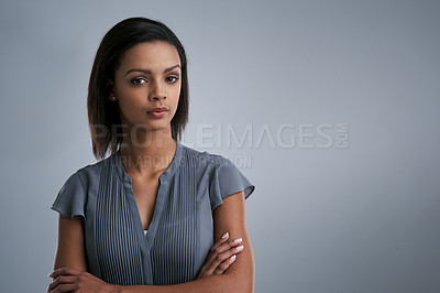 Buy stock photo Studio shot of a young woman posing against a gray background