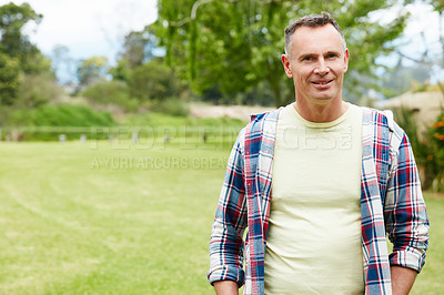 Buy stock photo Portrait of a mature man standing outside