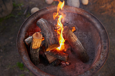 Buy stock photo Shot of logs burning in a barbeque
