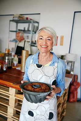 Buy stock photo Shot of a senior woman working in a bakery