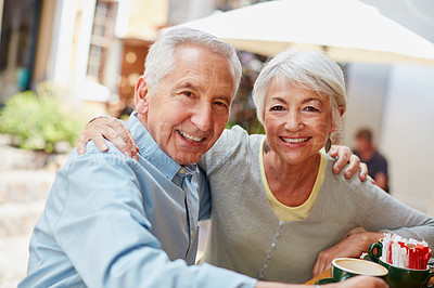 Buy stock photo Shot of a senior couple having coffee at a cafe
