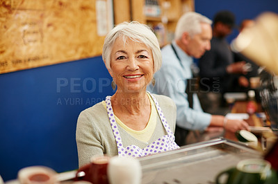 Buy stock photo Shot of a senior couple running a small business together