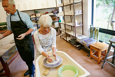 Buy stock photo Shot of a senior couple working with ceramics in a workshop