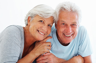 Buy stock photo Closeup portrait of senior couple relaxing together and smiling