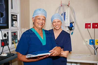 Buy stock photo Portrait of two surgeons working in a hospital