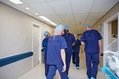 Buy stock photo Rearview shot of a medical team standing in a hospital