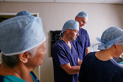 Buy stock photo Cropped shot of a medical team in the hospital
