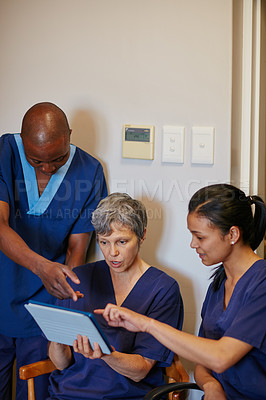 Buy stock photo Cropped shot of three medical professionals in the hospital