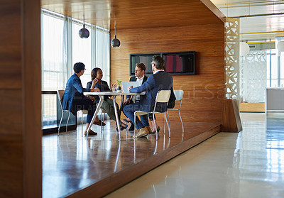 Buy stock photo Shot of a group of corporate businesspeople working in the boardroom
