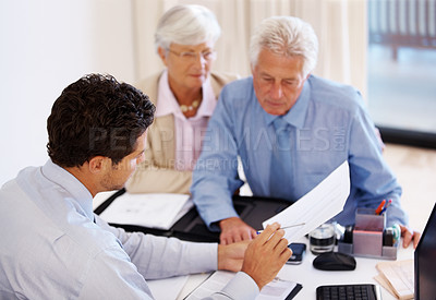 Buy stock photo Portrait of a mature couple consulting a real estate agent at office