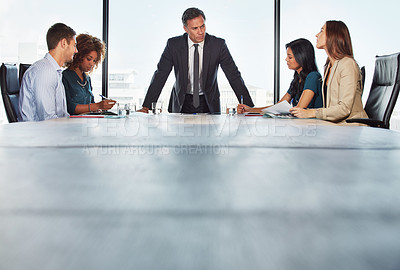 Buy stock photo Shot of a group of businesspeople in a meeting