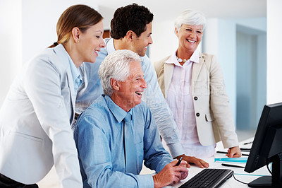 Buy stock photo Cheerful business group working on desktop computer at office