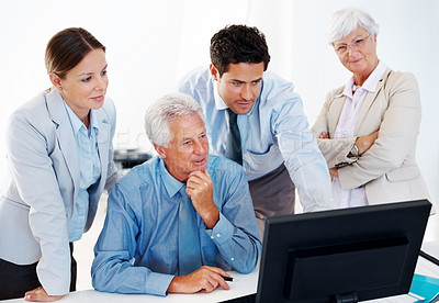 Buy stock photo Successful group of businesspeople together working on computer for new business project