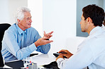 Financial planner discussing investment plans with a man