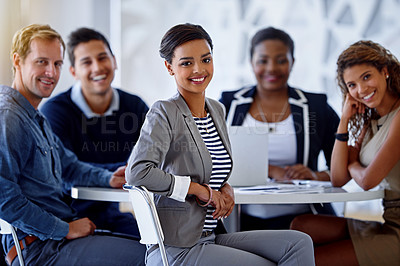Buy stock photo Portrait of a group of smiling colleagues sitting in an office