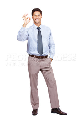 Buy stock photo Smiling young male business executive gesturing OK sign against white background