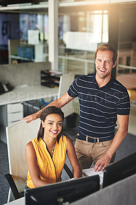 Buy stock photo Portrait of two smiling colleagues working together in an office