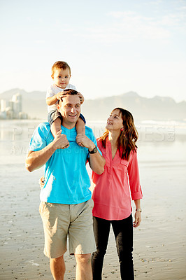 Buy stock photo Shot of a family of three enjoying a day at the beach