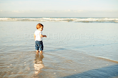 Buy stock photo Shot of a little boy playing on the beach