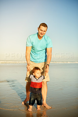 Buy stock photo Shot of a father spending the day at the beach with his son