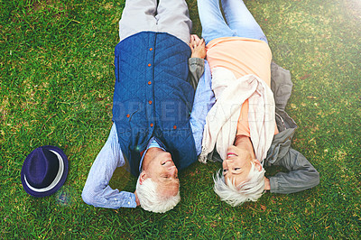 Buy stock photo Shot of a senior couple enjoying the day together in a park