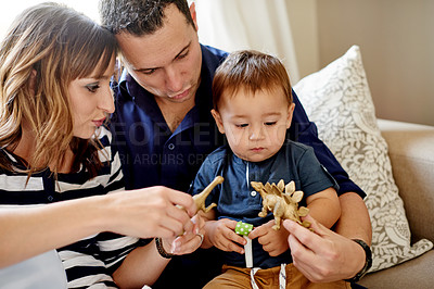 Buy stock photo Shot of a happy family playing with toys on their son's first birthday at home