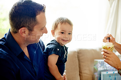 Buy stock photo Shot of an adorable little boy getting ready to blow out the candle on his first birthday