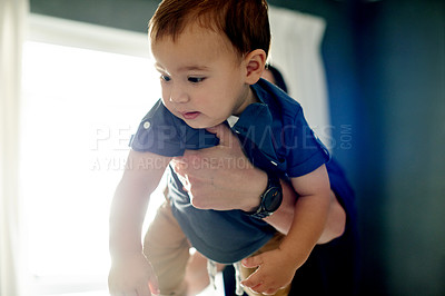 Buy stock photo Cropped shot of an adorable little boy being carried by his father