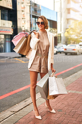 Buy stock photo Shot of a young woman out shopping in the city