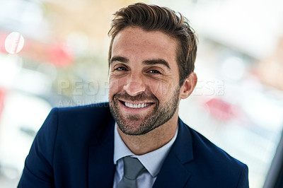 Buy stock photo Portrait of a young corporate businessman sitting in an office