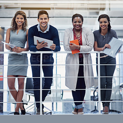 Buy stock photo Portrait of a group of smiling colleagues working together in an office
