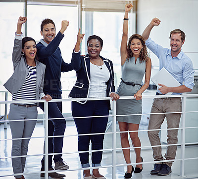 Buy stock photo Portrait of a group of colleagues celebrating together in an office