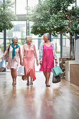 Buy stock photo Full length shot of a three senior women out on a shopping spree