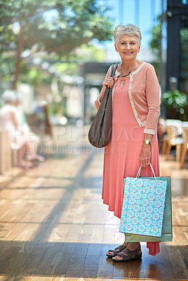 Buy stock photo Full length portrait of a senior woman out on a shopping spree