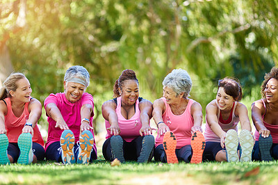 Buy stock photo Shot of a group of people warming up outdoors
