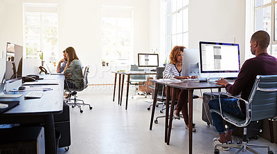 Buy stock photo Shot of colleagues working on their computers in an open plan office