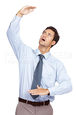 Buy stock photo Young male business executive showing about size of something big with hand over white background