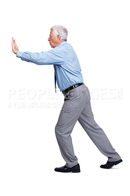 Buy stock photo Portrait of mature business man pushing against wall over white background