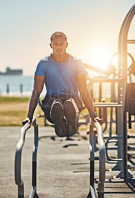 Buy stock photo Portrait of a young sporty man exercising outside