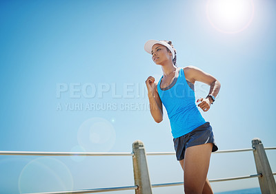 Buy stock photo Shot of a young sporty woman running outside