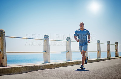 Buy stock photo Shot of a young sporty man running outside